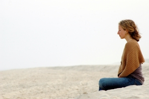 woman-meditating-beach